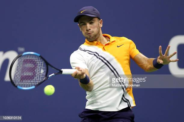 Borna Coric of Croatia returns the ball during his men's singles fourth round match against Juan Martin del Potro of Argentina on Day Seven of the...