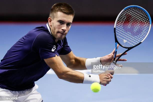 Borna Coric of Croatia returns the ball to Reilly Opelka of United States during their ATP St Petersburg Open 2020 international tennis tournament...