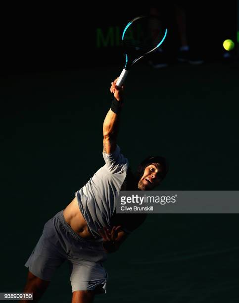 Borna Coric of Croatia serves against Denis Shapovalov of Canada in their fourth round match during the Miami Open Presented by Itau at Crandon Park...