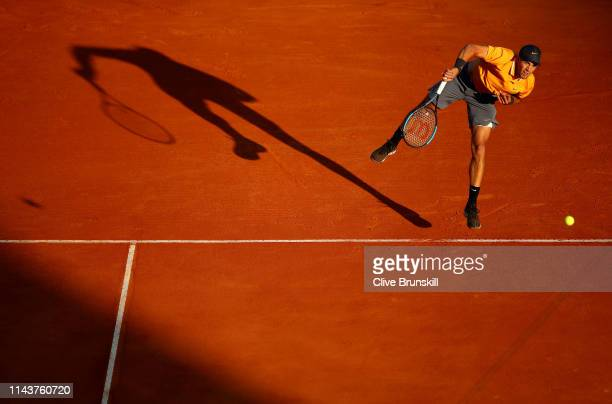Borna Coric of Croatia serves against Fabio Fognini of Italy in their quarter final match during day six of the Rolex MonteCarlo Masters at...
