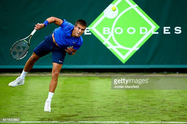 Borna Coric of Croatia serves during his match against Juan Martin del Potro of Argentina during day one of The Boodles Tennis Event at Stoke Park on...