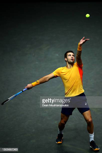 Borna Coric of Croatia serves in his match against Marton Fucsovics of Hungary during Day 6 of the 48th ABN AMRO World Tennis Tournament at Ahoy on...