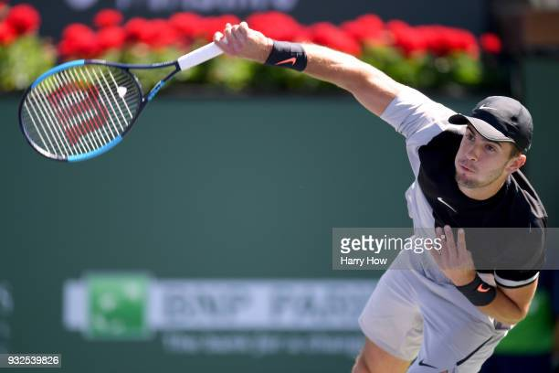Borna Coric of Croatia serves in his quarterfinal match against Kevin Anderson of South Africa during the BNP Paribas Open at the Indian Wells Tennis...