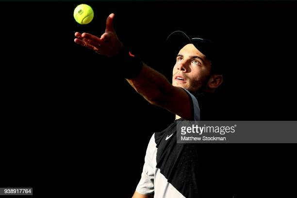 Borna Coric of Croatia serves to Denis Shapovalov of Canada during the Miami Open Presented by Itau at Crandon Park Tennis Center on March 27 2018 in...