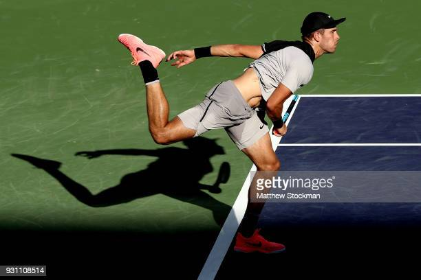Borna Coric of Croatia serves to Roberto Bautista Agut of Spain during the BNP Paribas Open at the Indian Wells Tennis Garden on March 12 2018 in...