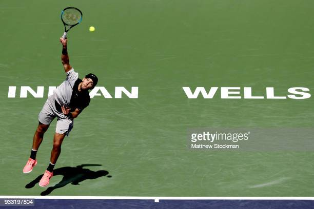 Borna Coric of Croatia serves to Roger Federer of Switzerland during the semifinal match on Day 13 of the BNP Paribas Open at the Indian Wells Tennis...