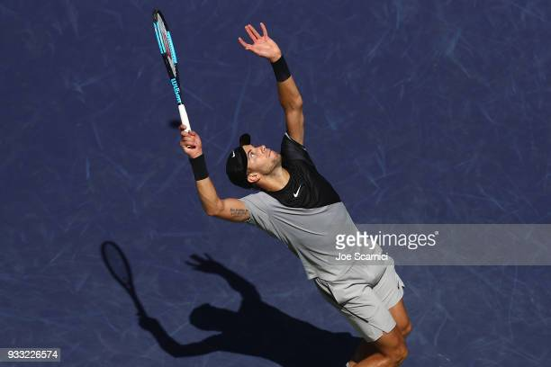Borna Coric of Croatia serves to Roger Federer of Switzerland during their semifinal match at BNP Paribas Open Day 13 on March 17 2018 in Indian...