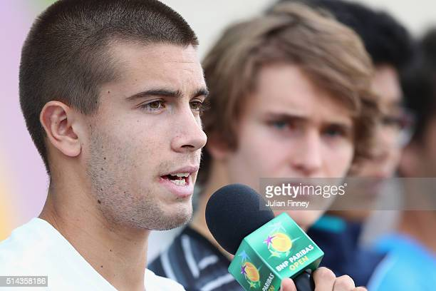 Borna Coric of Croatia talks to the public at the ATP World Tour #NextGen player panel during day two of the BNP Paribas Open at Indian Wells Tennis...