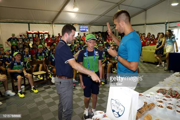 Borna Coric of Croatia talks with ball kids during Day 2 of the Western and Southern Open at the Lindner Family Tennis Center on August 12 2018 in...