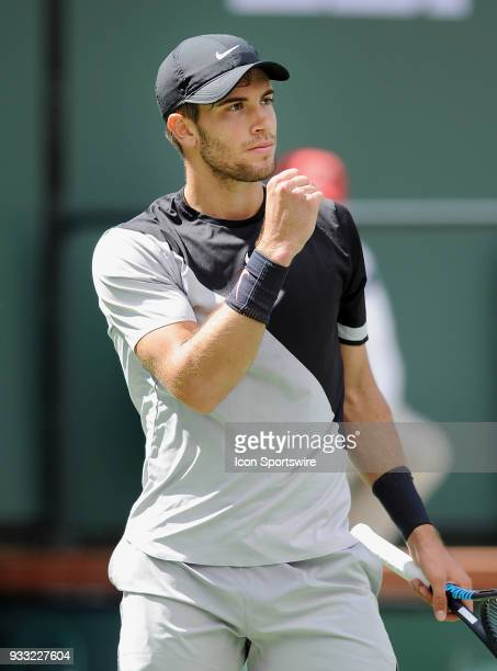 Borna Coric reacts after winning a point in the third set of a semifinals match played during the BNP Paribas Open on March 17 2018 at the Indian...