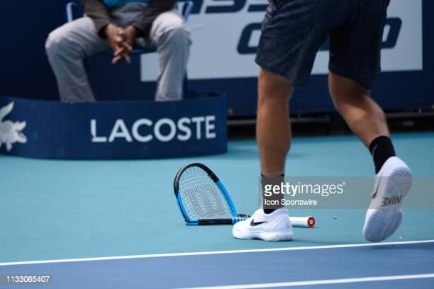 Borna Coric throws his racquet in his 4th round match at the Miami Open on March 26 2019 at Hard Rock Stadium in Miami Gardens FL