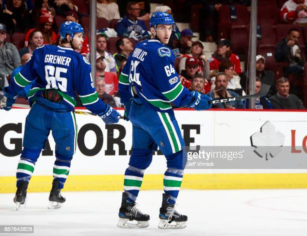 Borna Rendulic and Alexandre Grenier of the Vancouver Canucks skate up ice during their NHL game against the Detroit Red Wings at Rogers Arena...