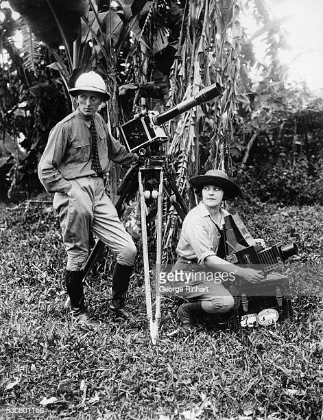 Mr Mrs Lou Hutt leaders of a 14month expedition into the Borneo Jungle with their movie and still camera equipment with which they procured a...
