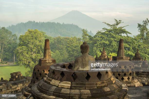 borobudur temple at sunrise, central java, indonesia - java stock pictures, royalty-free photos & images