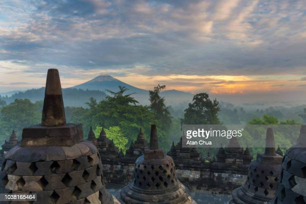 borobudur temple sunrise - yogyakarta stock pictures, royalty-free photos & images