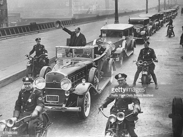 Borough President Julius Miller waves from open car in parade that marks the opening of the West Side Highway