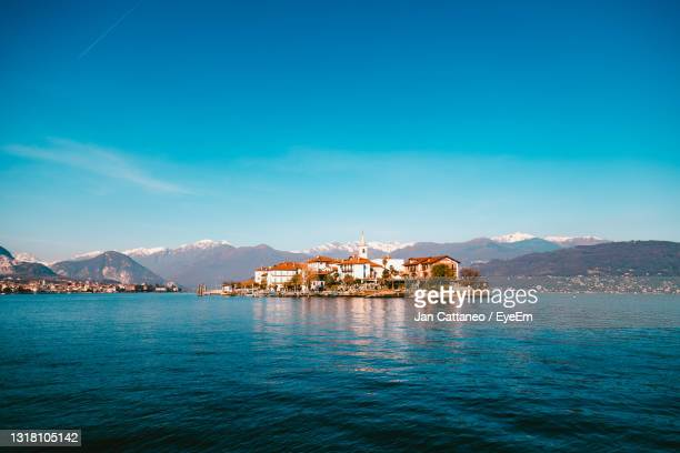 borromee island on lake maggiore seen from the boat carrying tourists - stresa stock pictures, royalty-free photos & images