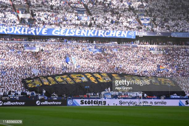 Borrussia Dortmund banner is seen amongst the FC Schalke 04 fans prior to the Bundesliga match between FC Schalke 04 and Borussia Dortmund at...