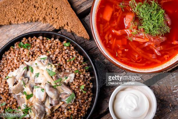 borsch and buckwheat porridge on a wooden board - buckwheat stock pictures, royalty-free photos & images