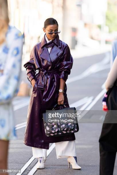 Borsha Kabir wearing a purple trench coat attends MercedesBenz Fashion Week Resort 20 Collections on May 14 2019 in Sydney Australia