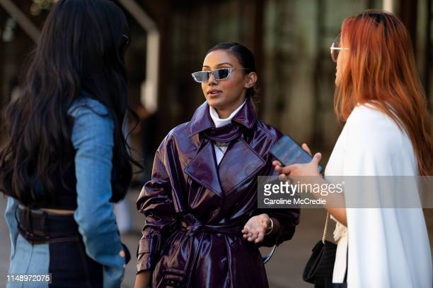 Borsha Kabir wearing a purple trench coat attends Mercedes-Benz Fashion Week Resort 20 Collections on May 14, 2019 in Sydney, Australia.