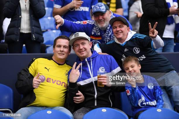 Borussia Dortmund and FC Shalke 04 fans enjoy the pre match atmosphere prior to the Bundesliga match between FC Schalke 04 and Borussia Dortmund at...