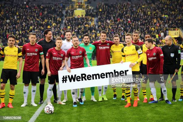Borussia Dortmund and Hannover 96 players show their support for victims of The Holocaust prior to the Bundesliga match between Borussia Dortmund and...