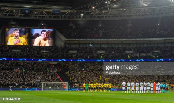 Borussia Dortmund and Tottenham Hotspur players line up during a minute silence in memory of former England goalkeeper Gordon Banks and Cardiff City...