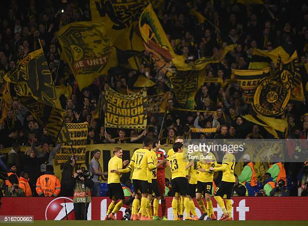 Borussia Dortmund celebrate victory with their fans after the UEFA Europa League round of 16 second leg match between Tottenham Hotspur and Borussia...