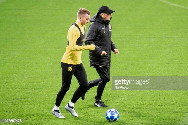 Borussia Dortmund coach Lucien Favre and Lukasz Piszczek during training session the day before UEFA Champions League match between Atletico de...