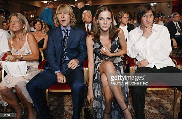 Borussia Dortmund Czech playmaker Tomas Rosicky his girlriend Radka Kocourova Juventus Czech midfielder Pavel Nedved and his wife Ivana attend 16...