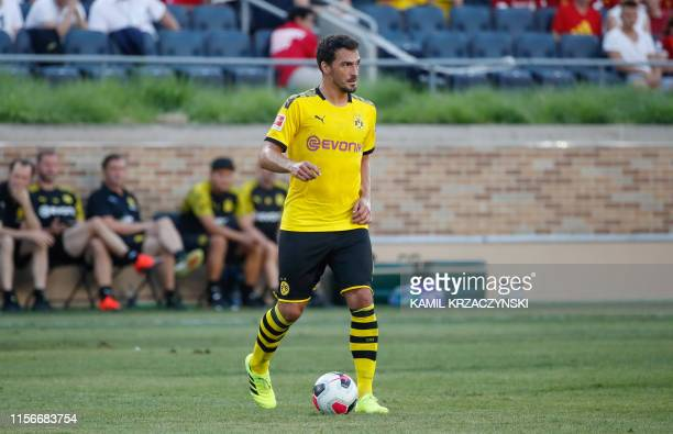 Borussia Dortmund defender Mats Hummels looks to pass the ball against Liverpool during the first half of the international friendly match at Notre...