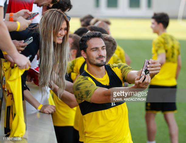Borussia Dortmund defender Mats Hummels poses for a selfie with a fan after a training session at Notre Dame Stadium in South Bend Indiana July 18...