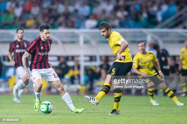 Borussia Dortmund Defender Sokratis Papastathopoulos in action against AC Milan Midfielder Jose Sosa during the International Champions Cup 2017...