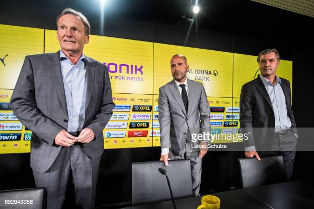 Borussia Dortmund Executive Director HansJoachim Watzke Peter Bosz the new head coach of Borussia Dortmund and Michael Zorc Director of Sports of...