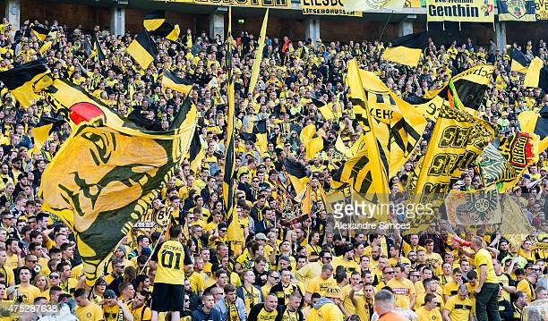 Borussia Dortmund fabs cheer on their team prior to the DFB Cup Final match between Borussia Dortmund and VfL Wolfsburg at Olympiastadion on May 30...