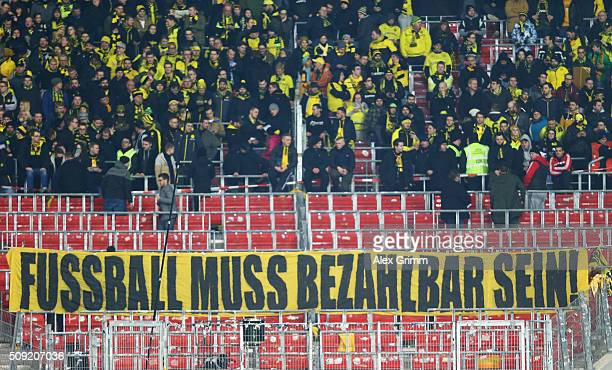Borussia Dortmund fans protest against seat ticket prices prior to the DFB Cup Quarter Final match between VfB Stuttgart and Borussia Dortmund at...