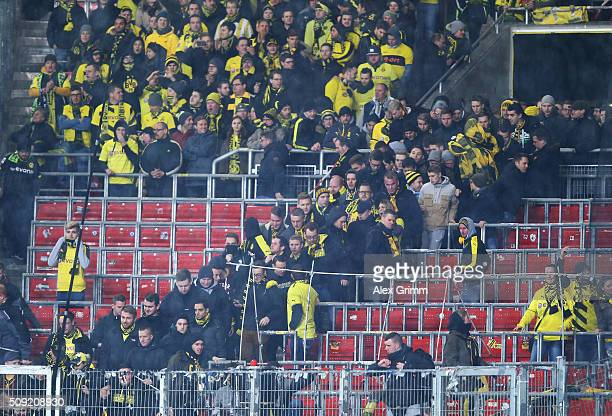 Borussia Dortmund fans return to their seats after a protest about ticket prices during the DFB Cup Quarter Final match between VfB Stuttgart and...