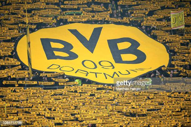 Borussia Dortmund fans show their support prior to the Bundesliga match between 1 FSV Mainz 05 and Borussia Dortmund at Opel Arena on November 24...