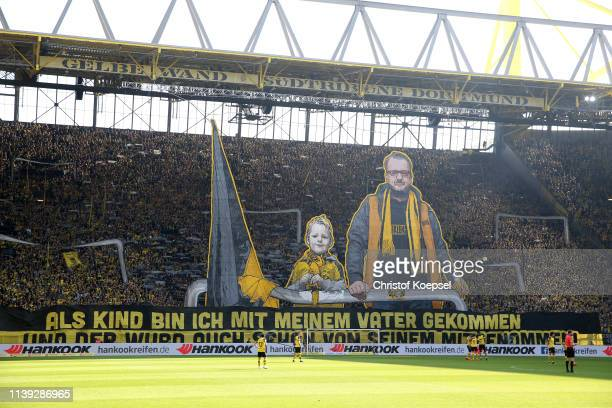 Borussia Dortmund fans show their support prior to the Bundesliga match between Borussia Dortmund and VfL Wolfsburg at Signal Iduna Park on March 30,...