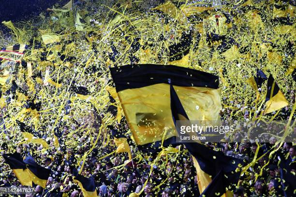 Borussia Dortmund fans show their support prior to the Bundesliga match between Borussia Dortmund and 1 FSV Mainz 05 at Signal Iduna Park on April 13...