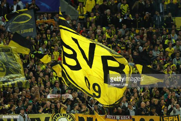Borussia Dortmund fans wave flags during the UEFA Champions League group H match between Tottenham Hotspur and Borussia Dortmund at Wembley Stadium...
