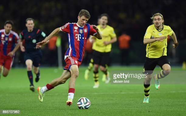 FUSSBALL DFB Borussia Dortmund FC Bayern Muenchen Thomas Mueller gegen Marcel Schmelzer