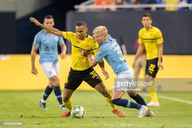 Borussia Dortmund goalkeeper Herbert Bockdorn battles Manchester City FC defender Oleksandr Zinchenko during an International Champions Cup match on...