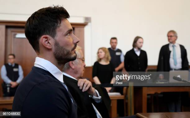 Borussia Dortmund goalkeeper Roman Buerki and Alfons Becker the lawyer of Borussia Dortmund sit at the witness box as defendant Sergej W is escorted...