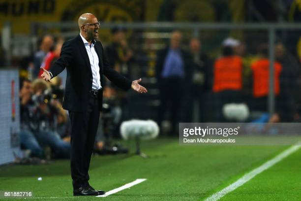 Borussia Dortmund Head Coach / Manager Peter Bosz signals to his players during the Bundesliga match between Borussia Dortmund and RB Leipzig at...
