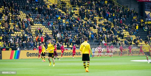 Borussia Dortmund is setting a sign against homophobia prior to the Bundesliga match between Borussia Dortmund and Eintracht Frankfurt at Signal...