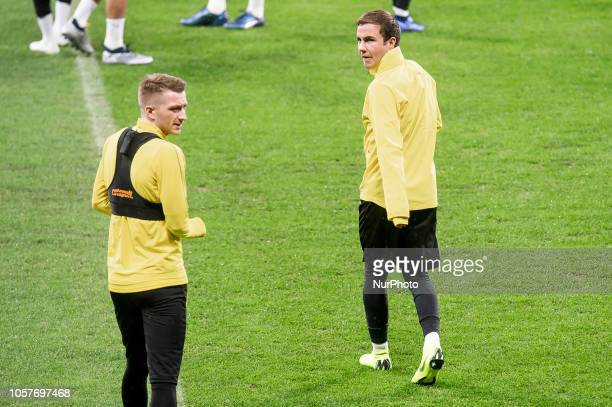 Borussia Dortmund Lukasz Piszczek and Mario Gotze during training session the day before UEFA Champions League match between Atletico de Madrid and...