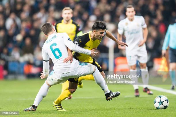 Borussia Dortmund Mahmoud Dahoud fights for the ball with Nacho Fernandez of Real Madrid during the Europe Champions League 201718 match between Real...