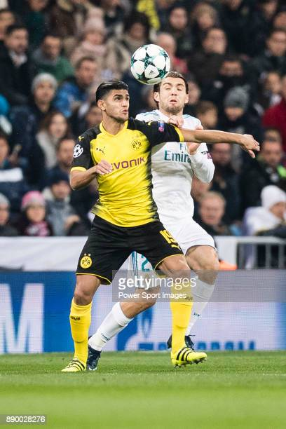 Borussia Dortmund Mahmoud Dahoud in action against Mateo Kovacic of Real Madrid during the Europe Champions League 201718 match between Real Madrid...